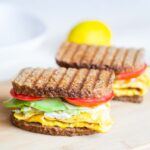 avocado egg sandwich on a wooden bard