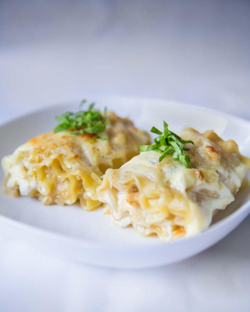 white chicken lasagna roll-ups with alfredo sauce