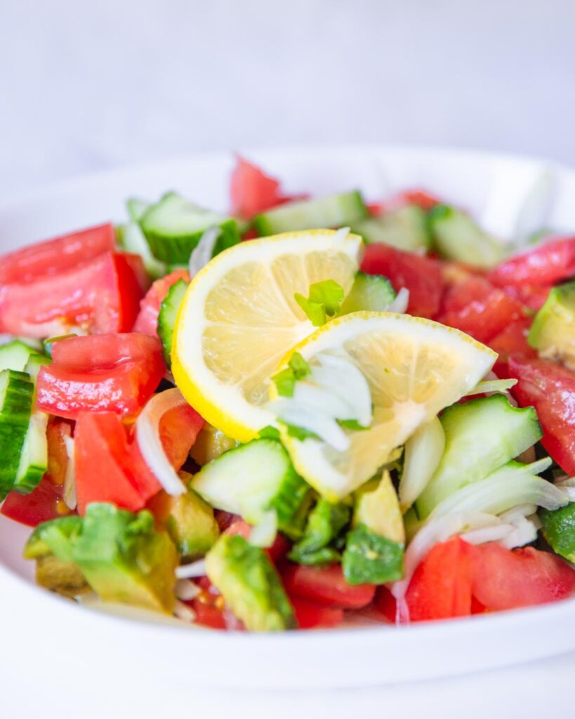 cucumber tomato and avocado salad with lemony dressing