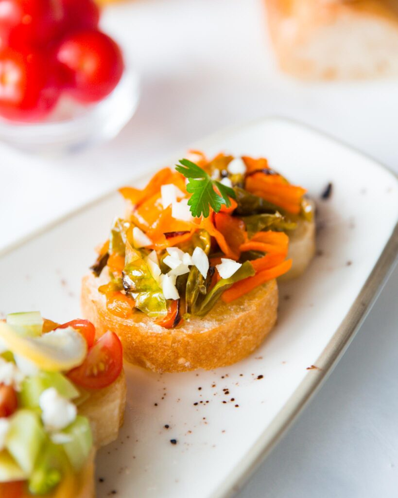 Mediterranean bruschetta with roasted peppers and onion