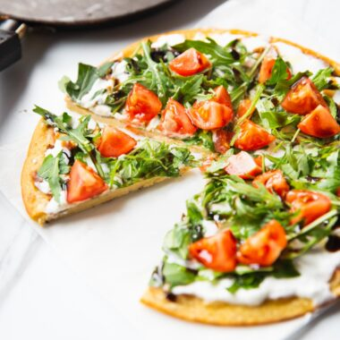 chickpea pancakes with arugula and tomato toppings