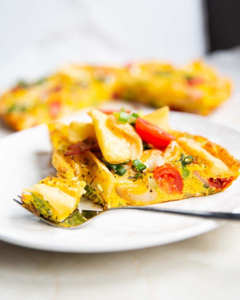 potato frittata served with cherry tomatoes on top