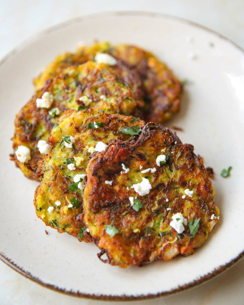 Greek zucchini fritters sprinkled with feta and parlsey on top